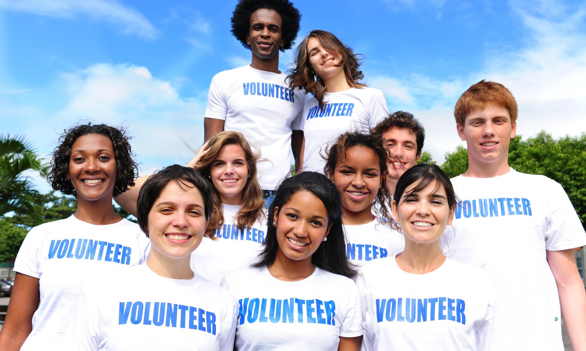 happy multi-ethnic volunteer group